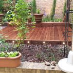 Deck installation, creating flower beds, laying chippings and lighting in Ilford, East London